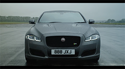 Jaguar has launched the new XJR575 with a high-speed interview starring designer Wayne Burgess being questioned by TV presenter and race driver Amanda Stretton as the performance saloon accelerates from 0-300km/h...