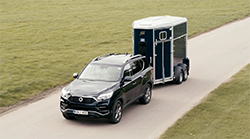 2018 Ssangyong Rexton towing a horse fload.